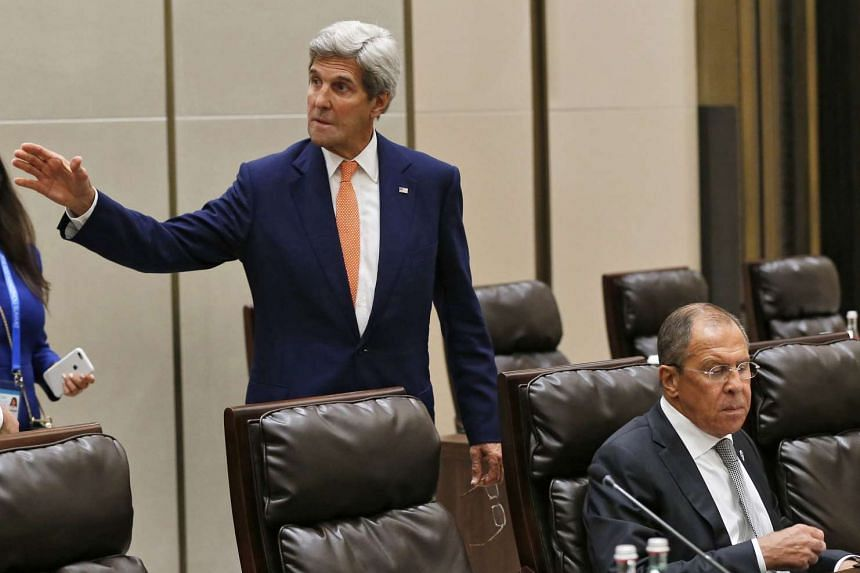 US Secretary of State John Kerry (centre) and Russian Foreign Minister Sergei Lavrov meet for a bilateral during the G20 Summit in Hangzhou, China on Sept 4, 2016.