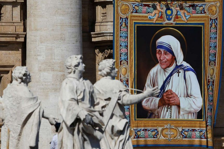 A tapestry depicting Mother Teresa of Calcutta is seen in the facade of Saint Peter's Basilica during a mass, celebrated by Pope Francis, for her canonisation in Saint Peter's Square on Sept 4, 2016.