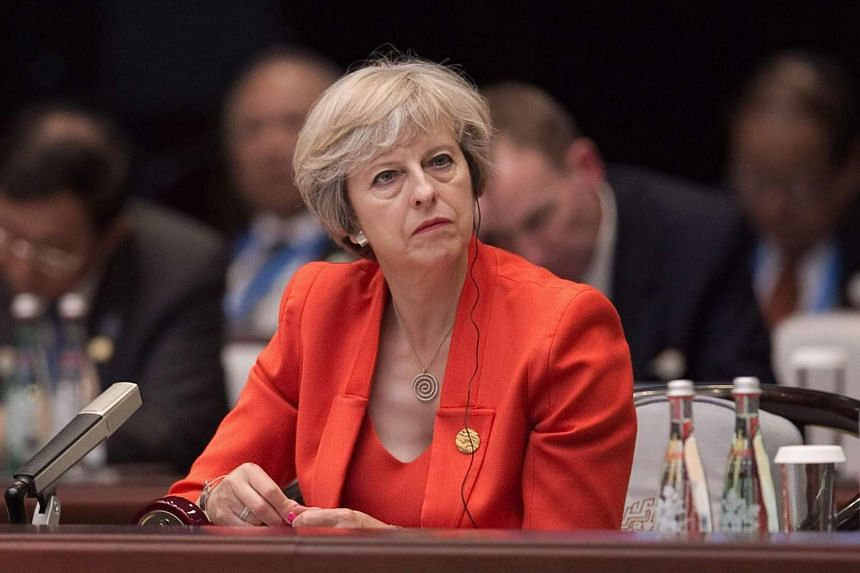 Britain's Prime Minister Theresa May listens to Chinese President Xi Jinping's (not pictured) speech during the opening ceremony of the G20 Summit at the International Expo Center in Hangzhou on Sept 4.