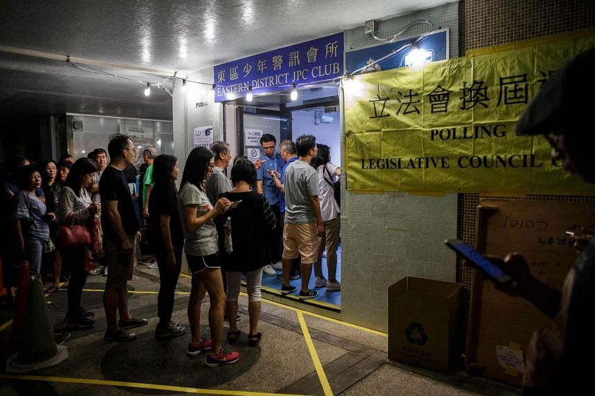 People queue to vote shortly before polls officially closed during the Legislative Council election in Hong Kong.