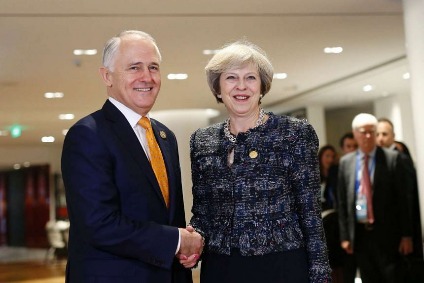 British Prime Minister Theresa May (right) shakes hands with Australian Prime Minister Malcolm Turnbull during a bilateral meeting on the sidelines of G20 Summit in Hangzhou on Sept 5, 2016.