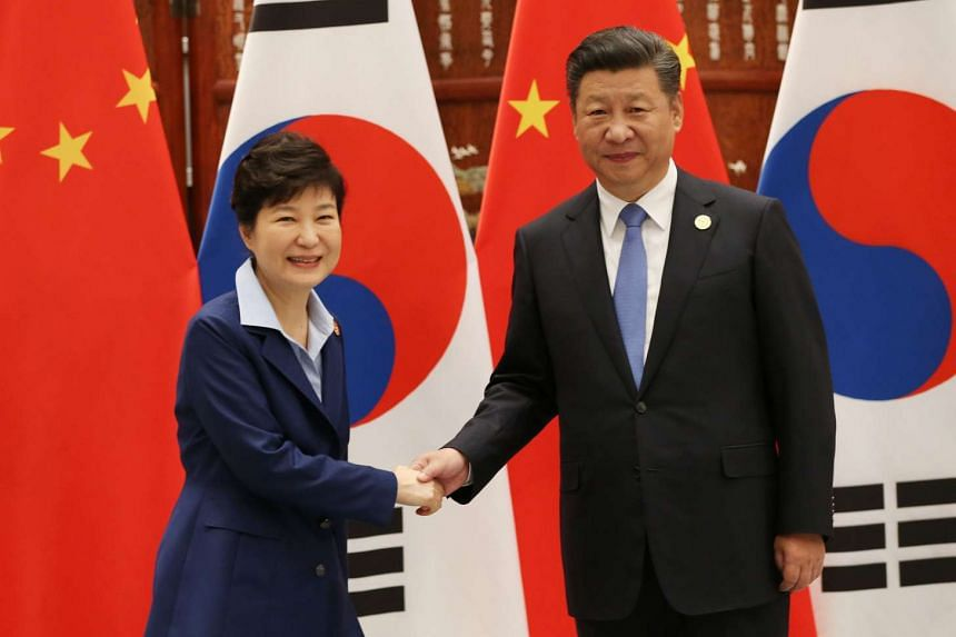 South Korean President Park Geun Hye (left) with Chinese President Xi Jinping prior to their meeting on the sideline of the G-20 summit at the West Lake State Guest House in Hangzhou on Sept 5, 2016.