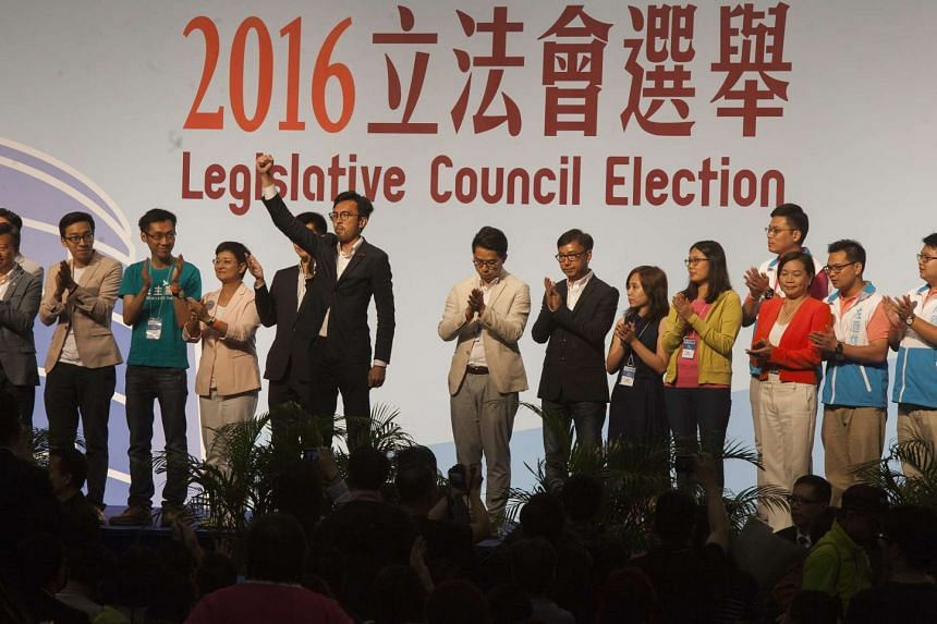 Kowloon West constituency candidate Avery Ng (centre-left) of the League of Social Democrats celebrates his election win as the results of the Hong Kong Legislative Council elections are announced on Sept 5, 2016.