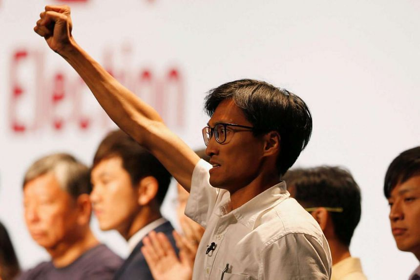 Democratic newcomer Eddie Chu celebrates his win in the Legislative Council election in Hong Kong.