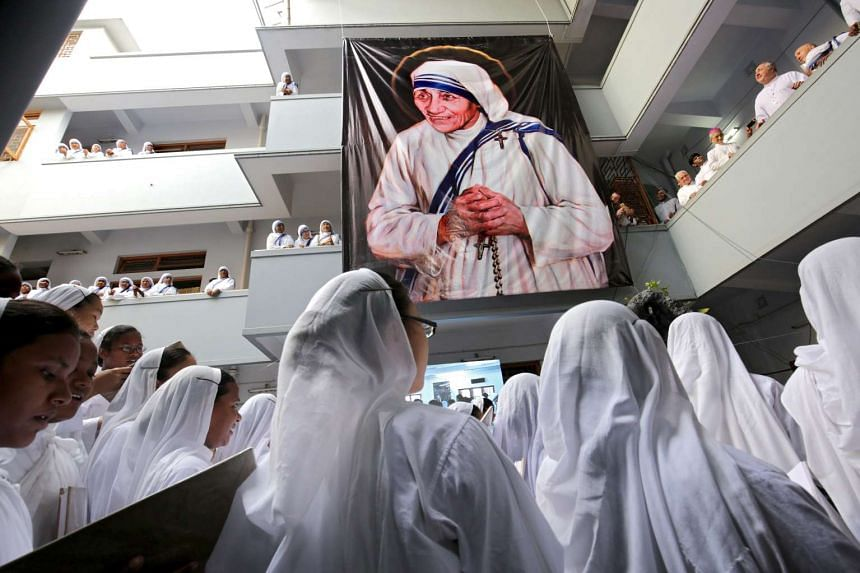 Nuns take part in a prayer during a mass marking Mother Teresa's 19th death anniversary at the Missionaries of Charity in Calcutta, India on Sept 5, 2016.