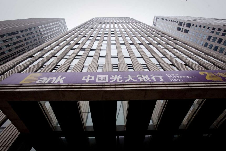 Signage for China Everbright Bank Co. hangs outside a branch in Beijing, China, on Aug 11, 2010.