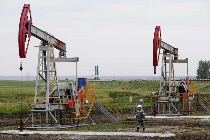 Pump jacks pump oil at an oil field owned by Bashneft company north from Ufa, Bashkortostan, Russia.