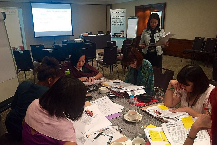 Educators taking part in a group activity during a feature writing workshop. Held on Aug 30 and 31, it was jointly developed by The Straits Times Schools department and specialists from English- language learning space Between the Lines.