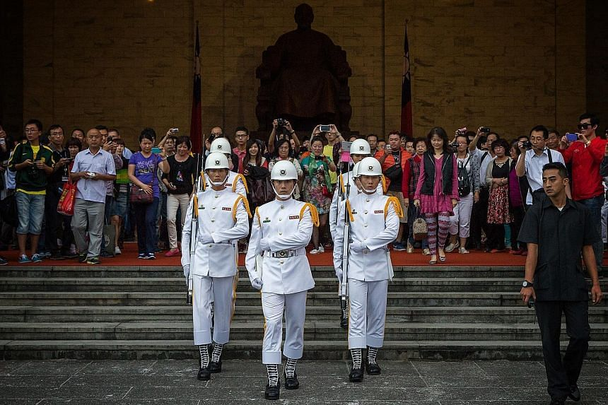 Guards marching at the Chiang Kai-shek Memorial Hall in Taipei - a sight that attracts many visitors. Besides a drop in Chinese tourist numbers, a check with tour agencies in Taiwan found that the Chinese are also spending much less.