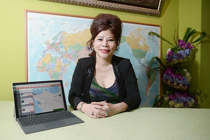 A website launched in March allows customers of Ms Sim's Albatross World Travel & Tours to book and pay for packages online. The laptop display next to the chief executive is of a personalised planning tool used to customise an itinerary to Bintan fr