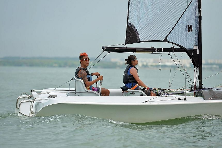 Jovin Tan (far left) with his sailing partner Yap Qian Yin training for the Paralympics. Tan hopes that he can eventually become a sailing coach for both para- and able-bodied sailors.