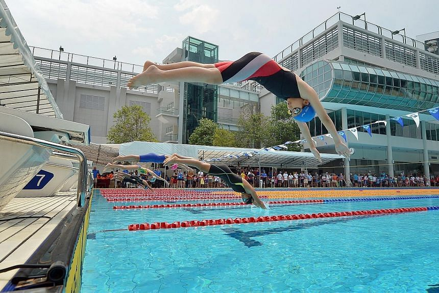 Swimmers from the 12-and-under girls' category diving off the blocks in the 100m freestyle heats at the inaugural CSC Super Junior Swimming Invitational. The two-day meet saw over 400 swimmers take part and will be an annual affair.
