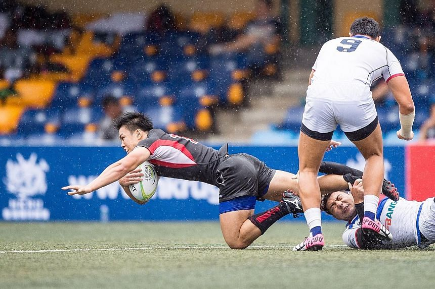 Singapore's Nicholas Yau (far left) in action against South Korea at the Hong Kong leg of the Asia Rugby Sevens Series. Singapore fell 0-46 in that pool match on Friday.