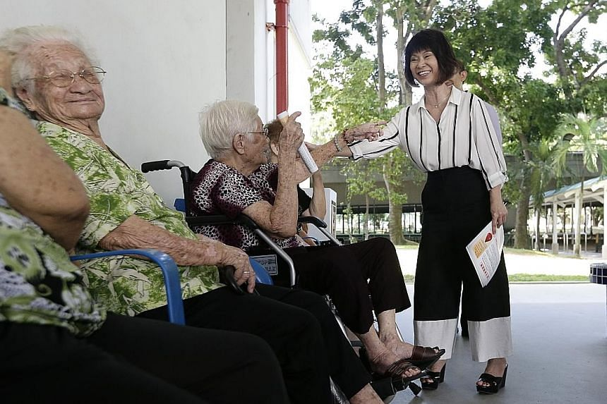 Dr Khor speaking to elderly residents in Paya Lebar Way about the Zika virus last week. Zika cases in Singapore have continued to rise, with another 27 detected by noon yesterday.