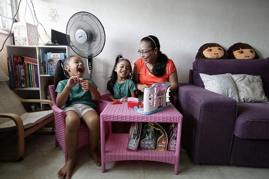 Madam Siti Zubaidah, who lives in Tampines, says she will avoid taking outdoors her daughters Amelia Shasmeen Azman (left), six, and Alisha Mia Shafana Azman, four.