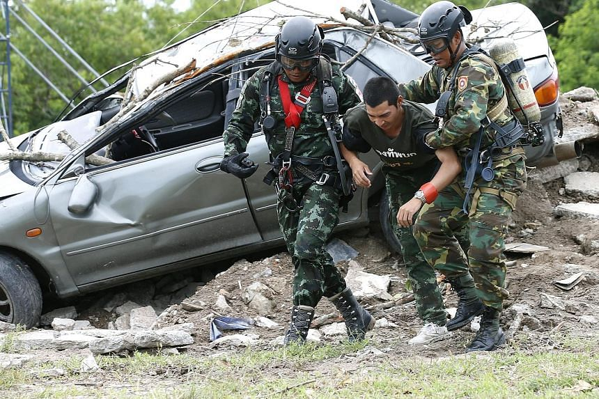 Military personnel from Laos and Thailand taking part in a humanitarian aid and disaster relief exercise yesterday at a military base in Chonburi province, Thailand. Hosted by Thailand, Laos, Russia and Japan, the Military Medicine - Humanitarian Ass