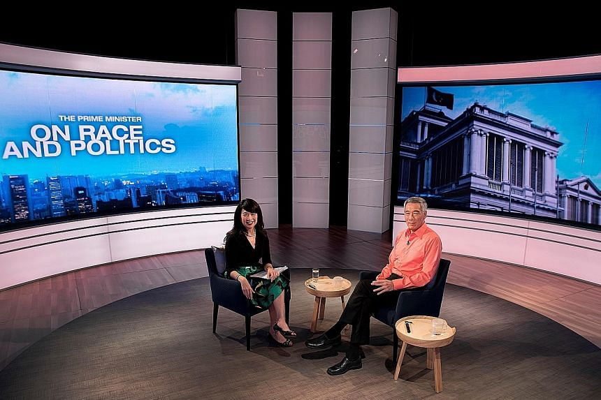 """PM Lee with Mediacorp's Debra Soon at the TV recording for The Prime Minister On Race And Politics, which was broadcast last night. He says that although all voters say they will vote for the best candidate, """"that definition differs depending on whic"""