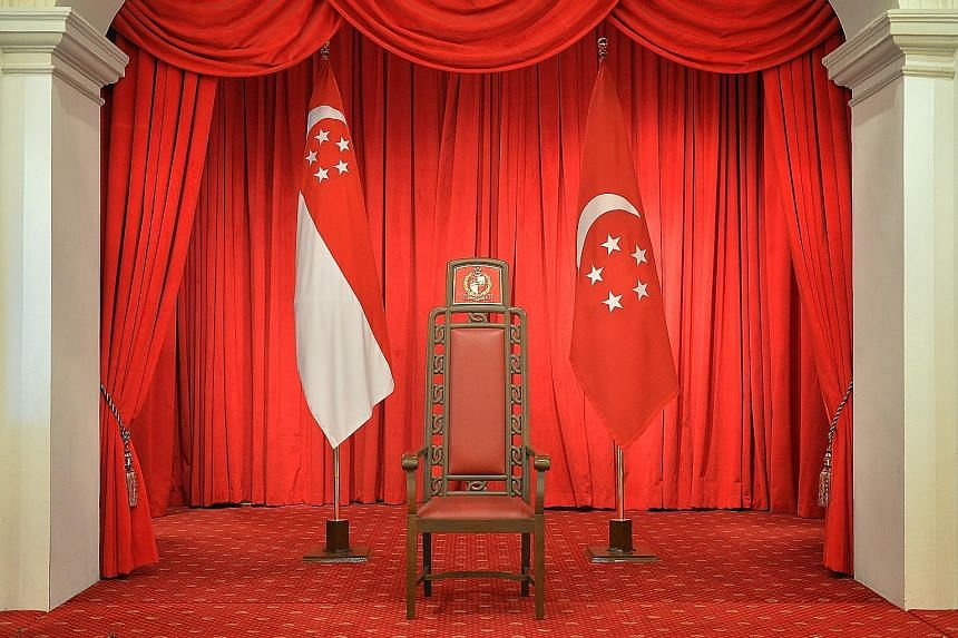 """The President's chair, flanked by the state flag and the presidential flag, at the Istana. The elected presidency is needed to """"stabilise the political system"""", says PM Lee."""