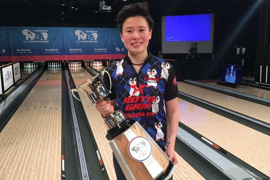 Singapore bowler New Hui Fen with her PWBA Tour Championship trophy.
