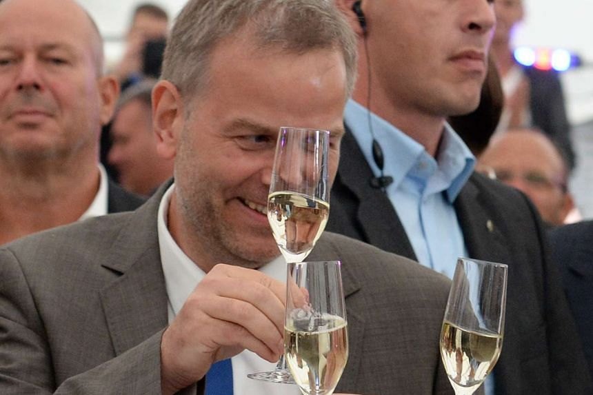 Leif-Erik Holm, top candidate of the anti-migrant populists AfD, celebrates as exit polls were announced on Sunday (Sept 4) in Schwerin, north-eastern Germany.