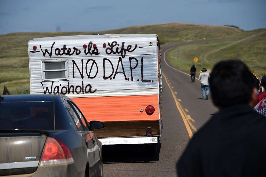 Protesters gather at the blocked entrance to a construction site for the Dakota Access Pipeline.