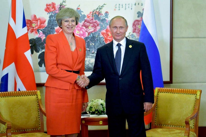 Russian President Vladimir Putin (right) meets with Britain's Prime Minister Theresa May on the sidelines of the G20 Summit in Hangzhou on Sunday (Sept 4).