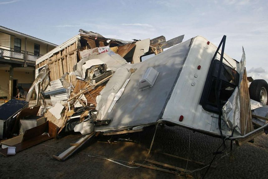 A destroyed travel trailer sits near the bay after rain and wind from Hurricane Hermine hit the town of Keaton Beach, Florida.
