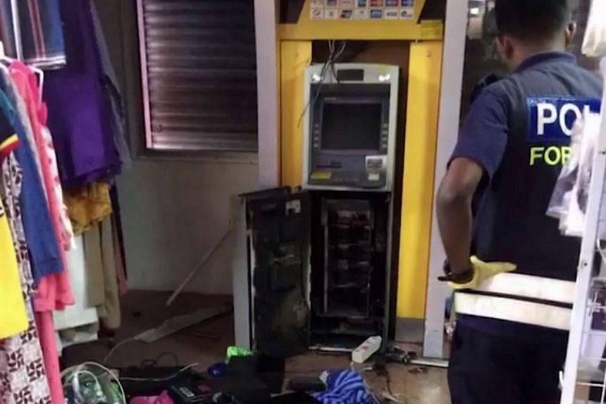 An ATM at a hypermarket in Kuala Nerus that robbers succeeded in cutting open.