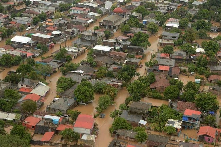 Floodwaters cover the streets after Hurricane Newton brought heavy rains to Benito Juarez, Mexico, on Sept 5, 2016.