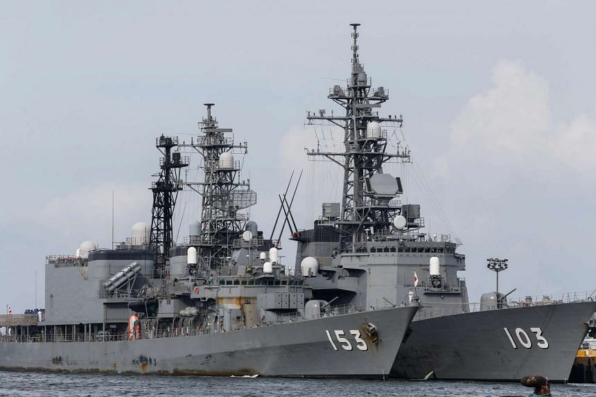 The Japanese destroyers JS Yugiri (left) and JS Yudachi are seen docked in Manila South Harbour during a goodwill visit on Aug 31, 2016.