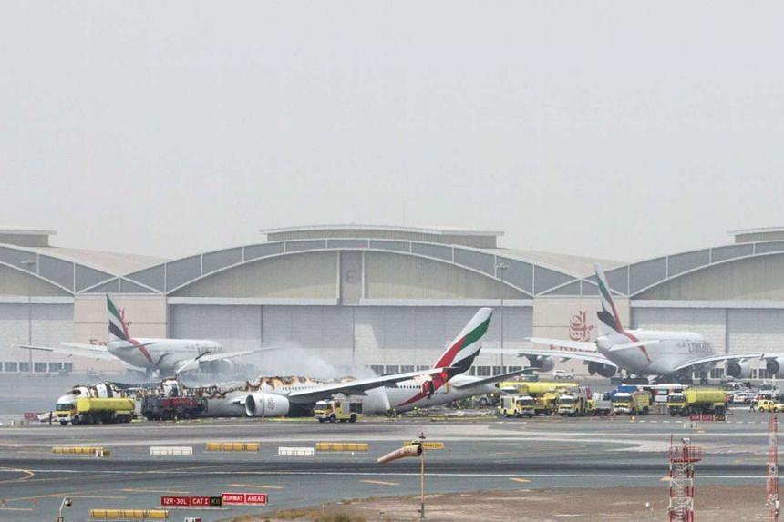 Emirates flight EK521 is seen after it crash-landed at Dubai International Airport, the UAE, on Aug 3, 2016.