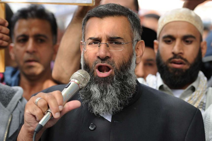 Anjem Choudary, Britain's best-known Islamist preacher speaking to a group of demonstrators on Sept 15, 2016.