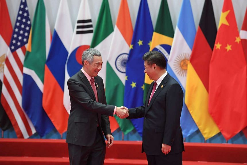 Prime Minister Lee Hsien Loong shakes hands with Chinese President Xi Jinping at the G20 Summit in Hangzhou, China, on Sept 3.