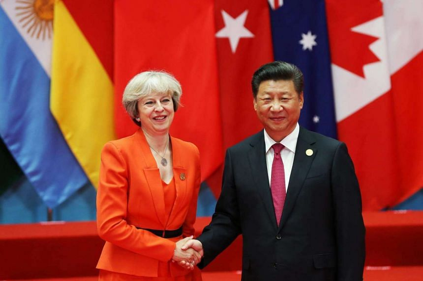 Chinese President Xi Jinping and British Prime Minister Theresa May pose for a photo at the G-20 summit in Hangzhou, China.