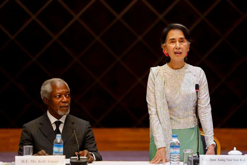Myanmar's Aung San Suu Kyi delivers the opening speech as former UN secretary general Kofi Annan sits beside her during their meeting in Yangon.