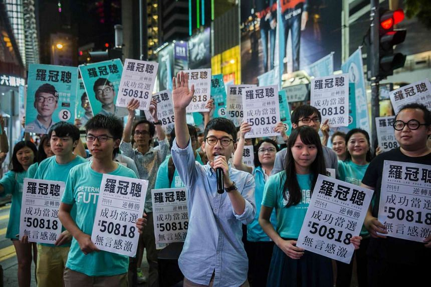 Nathan Law (centre), one of Hong Kong's new young lawmakers, speaks at a rally in Causeway bay following his win in the Legislative Council election in Hong Kong on Sept 5, 2016.
