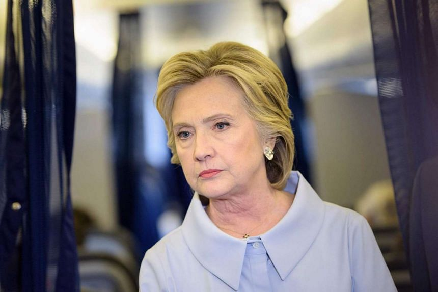 Democratic presidential nominee Hillary Clinton speaks to the press on board her plane on Sept, 2016.