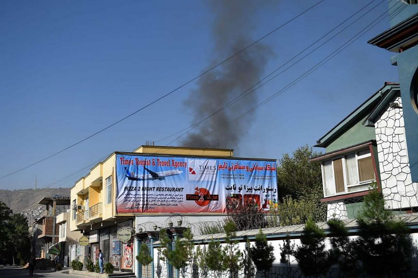 Smoke rises from a building during an attack on a charity at the Shar-e-Naw in Kabul on Sept 5, 2016.