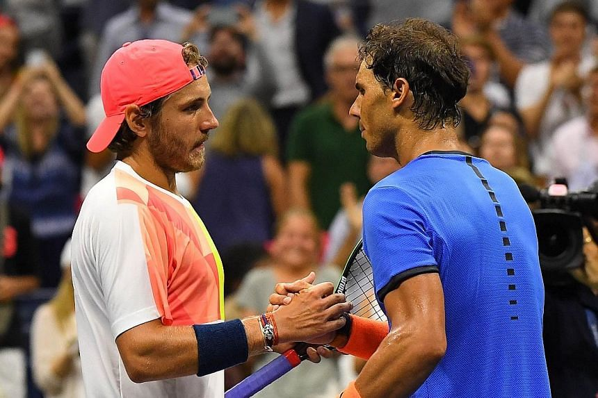 Underdog Pouille (left) beat Nadal in their fourth-round encounter at Flushing Meadows on Sunday.