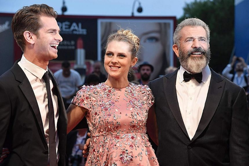 Director Mel Gibson (above right) with Hacksaw Ridge's cast members - actor Andrew Garfield and actress Teresa Palmer - at the film's premiere in Venice on Sunday. Celebrities on the red carpet included Sistine Stallone, daughter of actor Sylvester Stallo