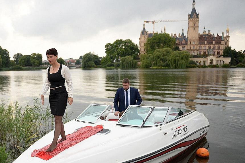Under the leadership of Ms Frauke Petry, seen here arriving on a boat for an election results party on Sunday in Schwerin, north-eastern Germany, the populist AfD has shifted its emphasis to anti-immigration questions - and has thrived.