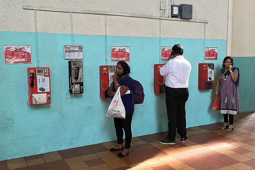 About 25 people were seen using the payphones in Tekka Centre in five hours. Some needed a payphone because the batteries in their mobile phones had run out, while others had forgotten to take their phones.
