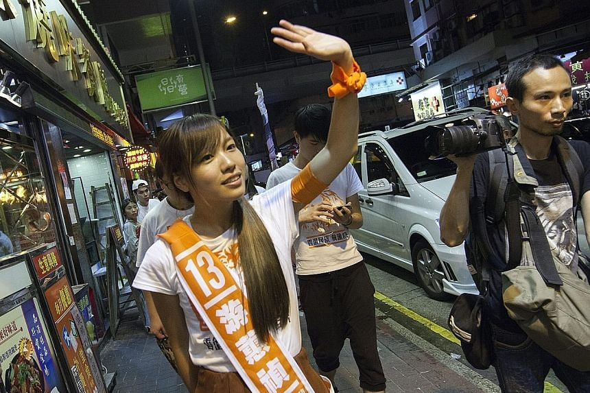 Right: Mr Leung, a Youngspiration candidate, won a seat in New Territories East. Below: Ms Yau, of Youngspiration, also won a seat. Bottom: Independent contender Mr Chu won a seat in New Territories West.