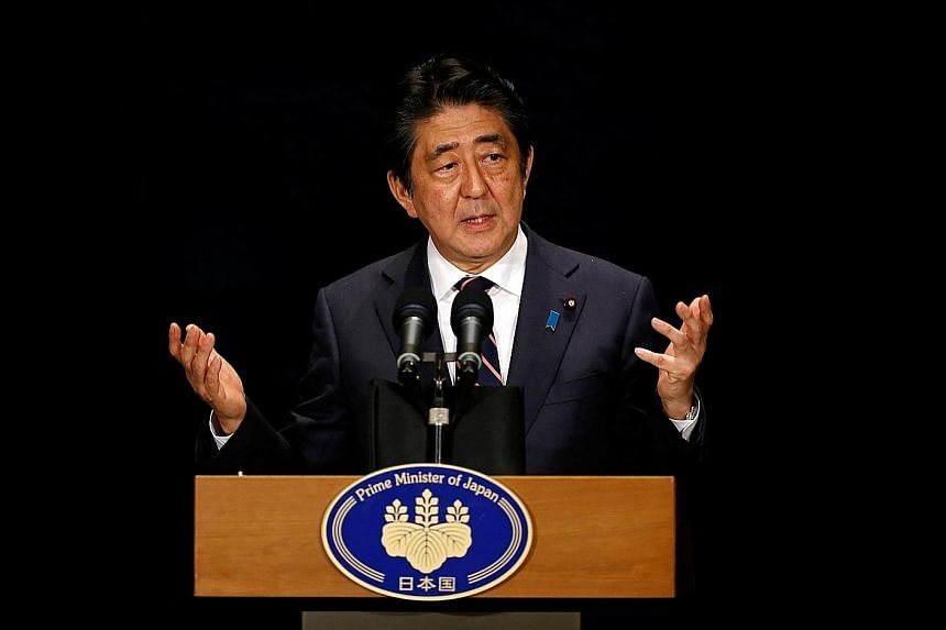 Mr Abe (above) and Mr Xi pledged to speed up talks on the setting up of a maritime hotline between senior defence officials of both countries to prevent accidental clashes in the East China Sea.