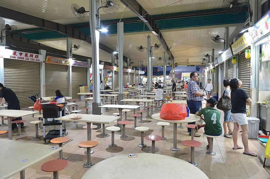 The food centre at Block 117, Aljunied Avenue 2 yesterday. Business in the Sims Drive and Aljunied Crescent area has suffered since the Zika outbreak.