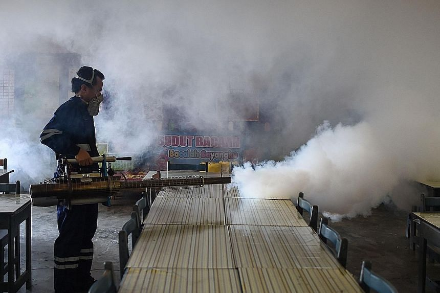 A school classroom being fumigated on the eve of the annual national Primary School Evaluation Test in Kuala Lumpur on Sunday. Malaysia has so far recorded two Zika infections.