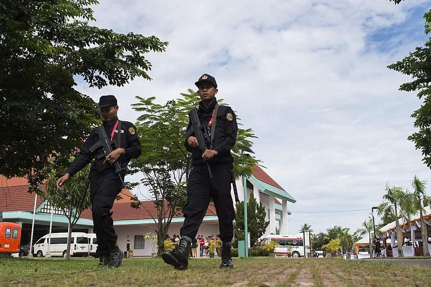 Laotian security personnel patrolling the Asean media centre at the National Convention Centre in Vientiane yesterday. The Asean meetings will be attended by leaders of all 10 Asean member countries.