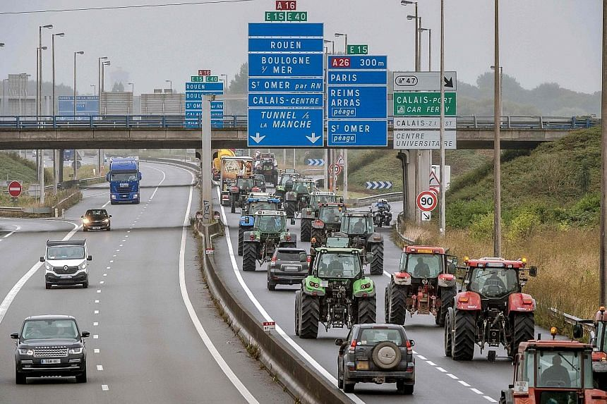 """Truck drivers and farmers driving from Loon Plage to Calais on the A16 highway yesterday during a joint """"go-slow"""" protest calling for the dismantling of the so-called """"Jungle"""" migrant camp in Calais."""
