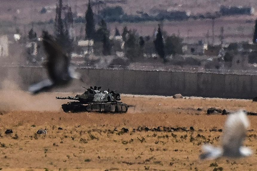 A Turkish tank advancing from Syria during clashes between the Turkish army and ISIS militants on Sunday.