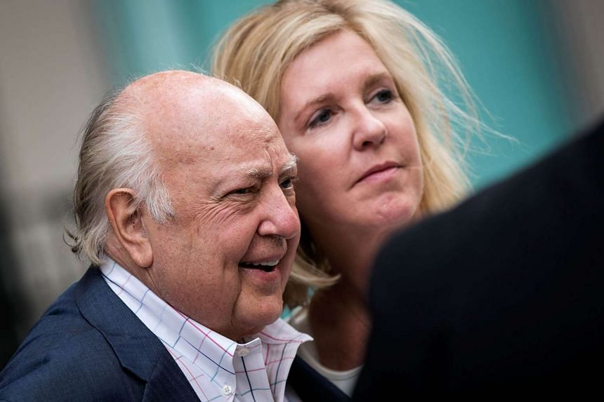 Roger Ailes walks with his wife Elizabeth Tilson as they leave the News Corp building, July 19, 2016, in New York City.